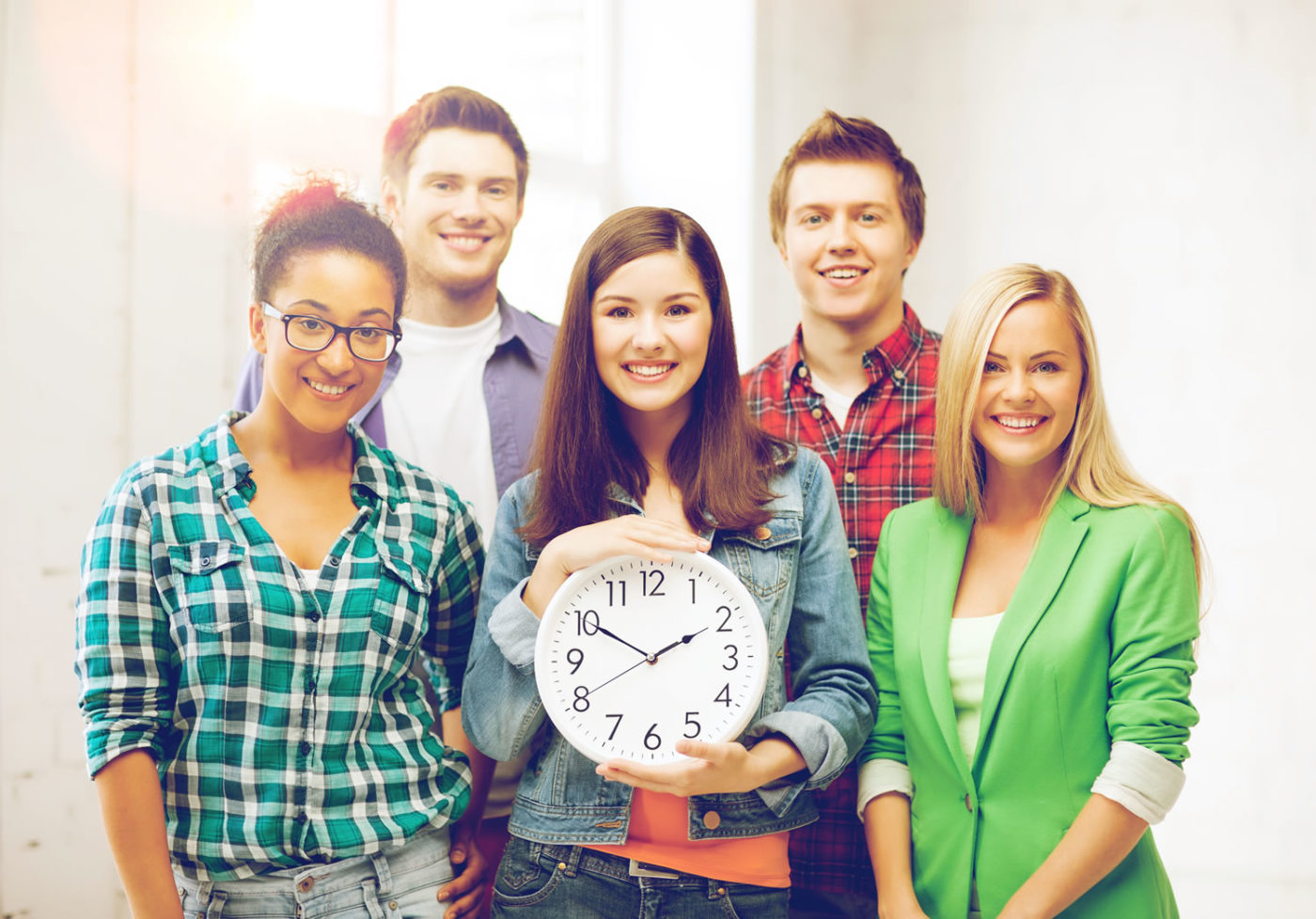 Group of five students representing education and time