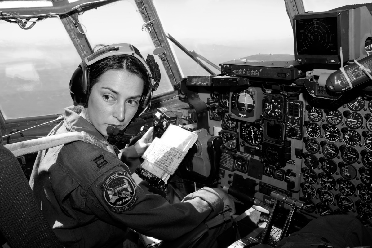 Female Military Reservist Pilot in a cockpit
