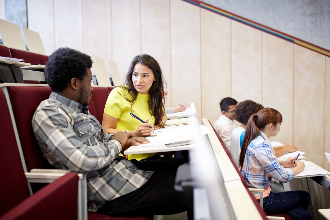 Students discussing topics in lecture hall