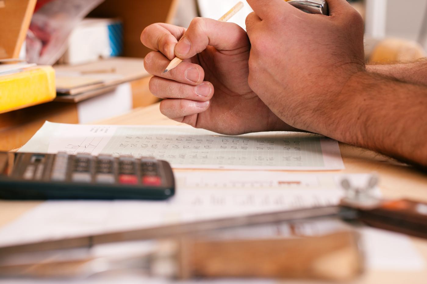 Carpentry closeup of man using pencil