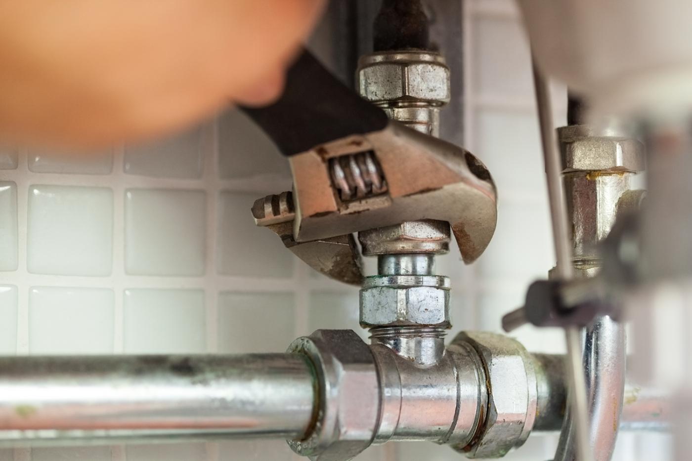Plumbing hand repairing pipe