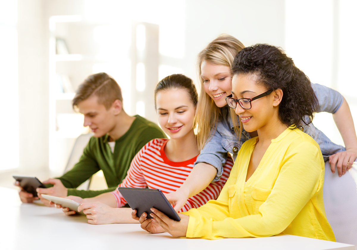 Smiling Students Looking At Tablet