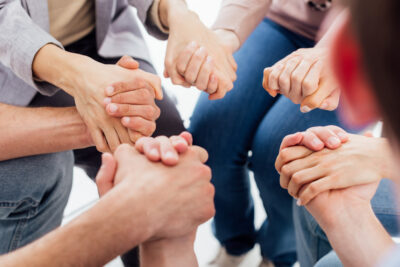 People Holding Hands For Encouragement