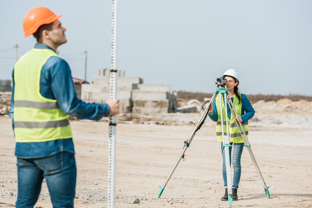 Surveyors Using Digital Level