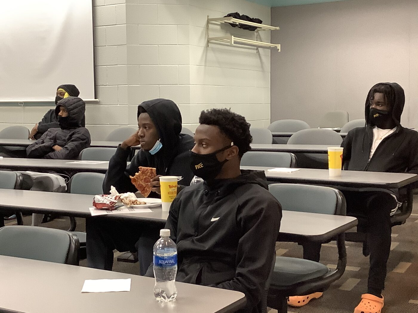 FTCC men's basketball players listen to a lesson during a life skills class