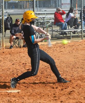 Chloe Radford hits the ball
