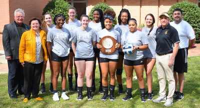 Volleyball team photo with Region 10 runner-up trophy