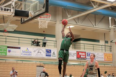 Johnny Hughes dunks the basketball during a Mount Olive basketball game