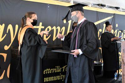 029 Dean Prevatte Fist Bumps A Graduate In Tent C